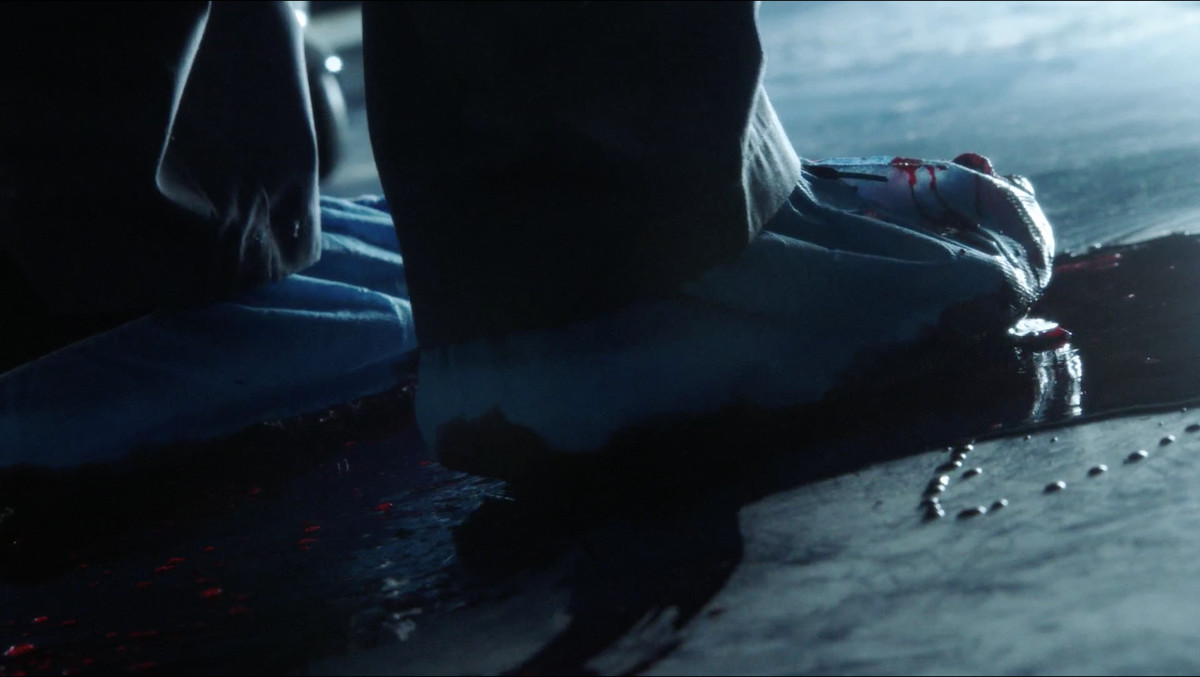 Picture of a doctor stepping on blood in the operating room in 'The Resident'