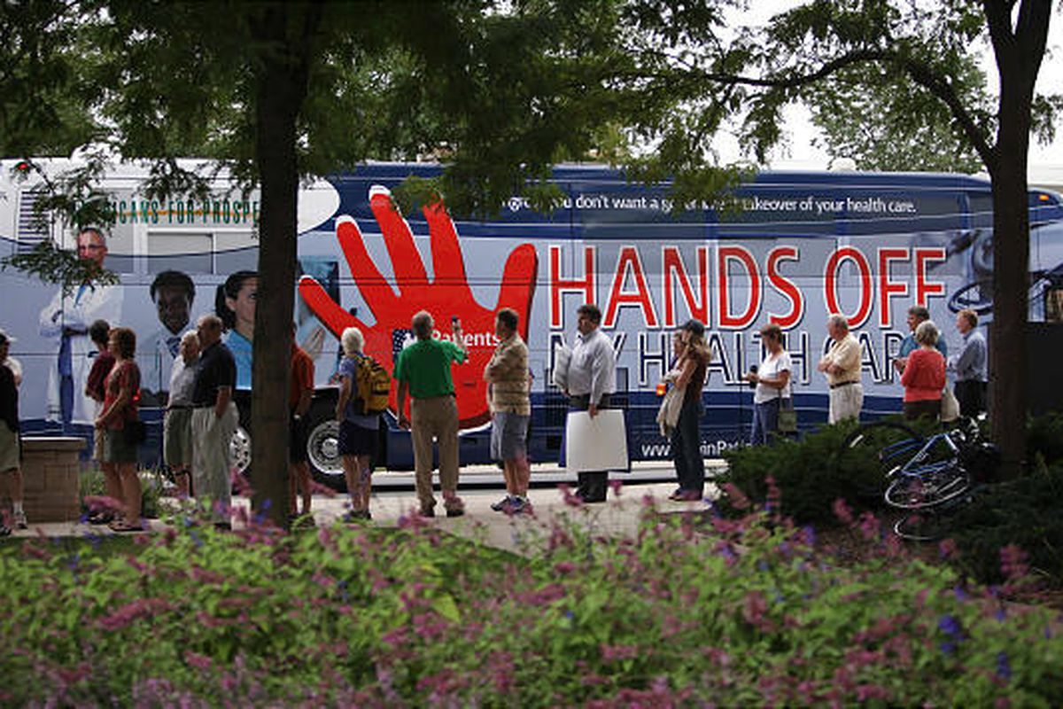 The Patients First bus rolls up to a  town hall meeting to be lead by Sen. Arlen Specter, D-Pa., on health care in at Penn State University in State College, Pa, Wednesday. More than 400 attended and opponents occasionally drowned out the Republican-turne