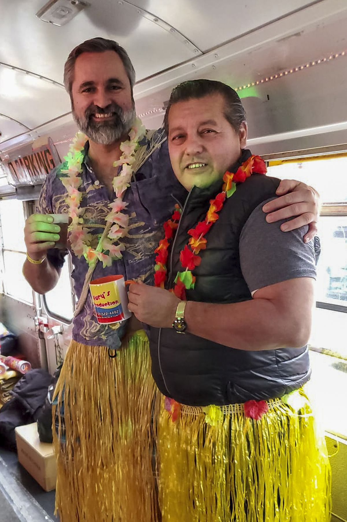 La Chiva Loca's owner, Yury Arias (right) with a partygoer for a Hawaii themed party in the winter before the pandemic.