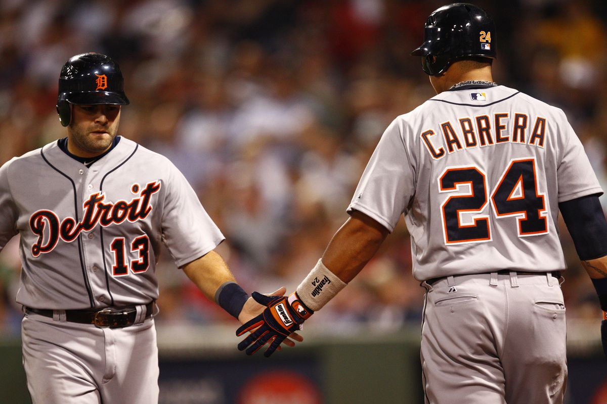 Aug 1, 2012; Boston, MA, USA; Detroit Tigers catcher Alex Avila (13) celebrates with third baseman Miguel Cabrera (24) against the Boston Red Sox during the fifth inning at Fenway Park.  Mandatory Credit: Mark L. Baer-US PRESSWIRE