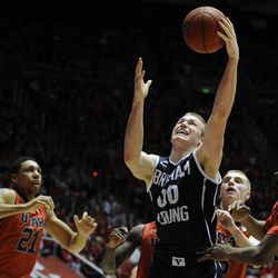 Brigham Young Cougars forward Eric Mika (00) grabs a rebound between the Utes defense during a game at the Jon M. Huntsman Center on Saturday, December 14, 2013.