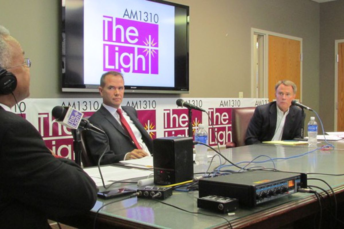 WTLC's Amos Brown (left) moderates a debate between Republican Chuck Brewer (center) and Democrat Joe Hogsett (right).