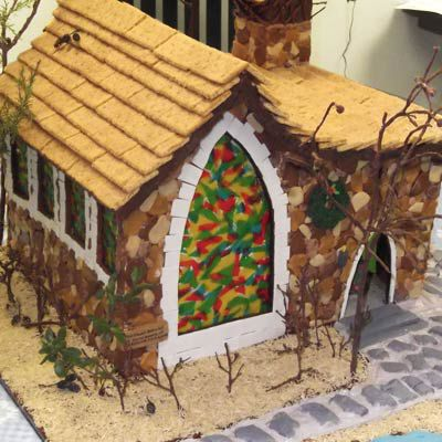 A gingerbread chapel with a window made of fruit roll ups.