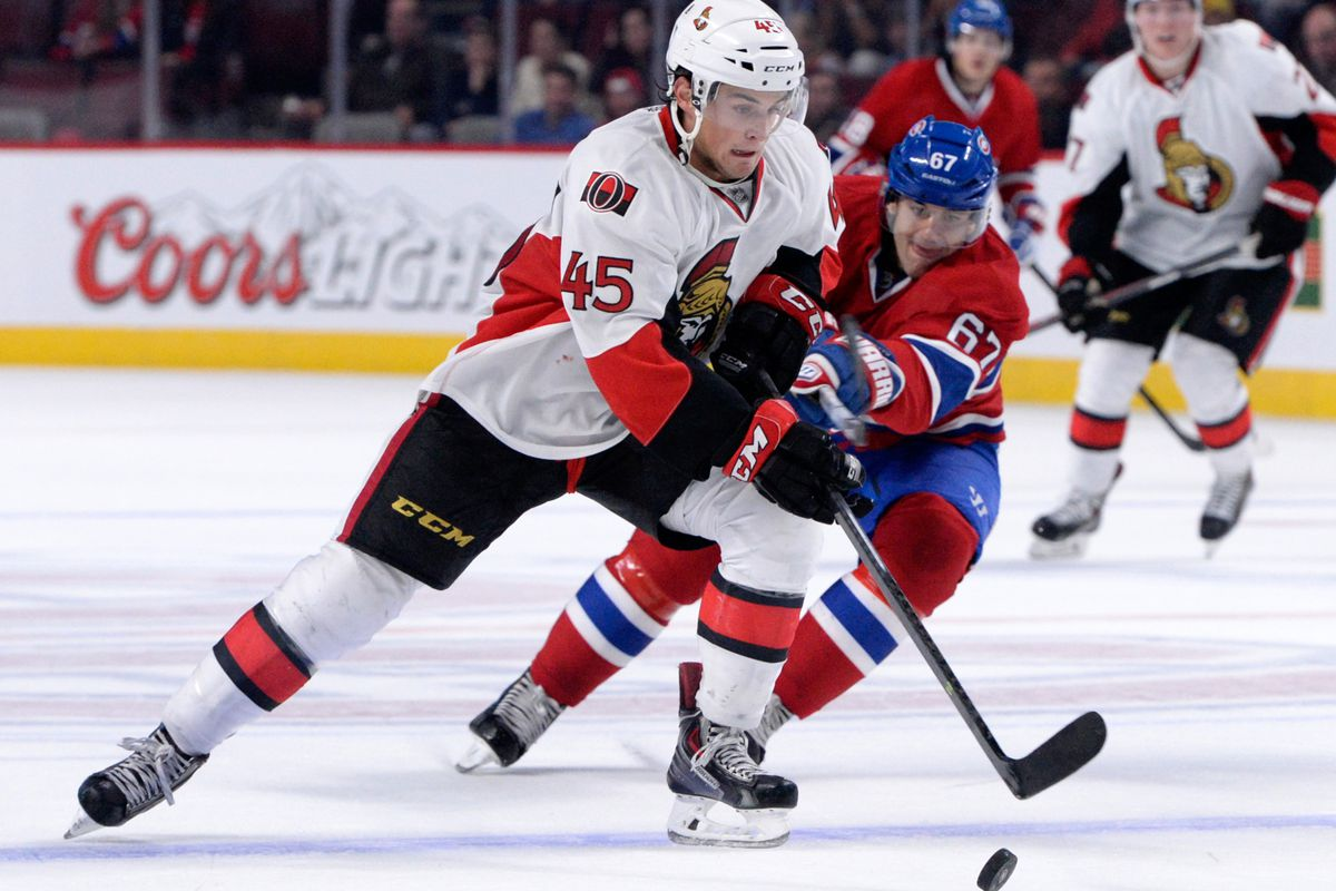 Chris Wideman keeps the puck away from Pacioretty in preseason action