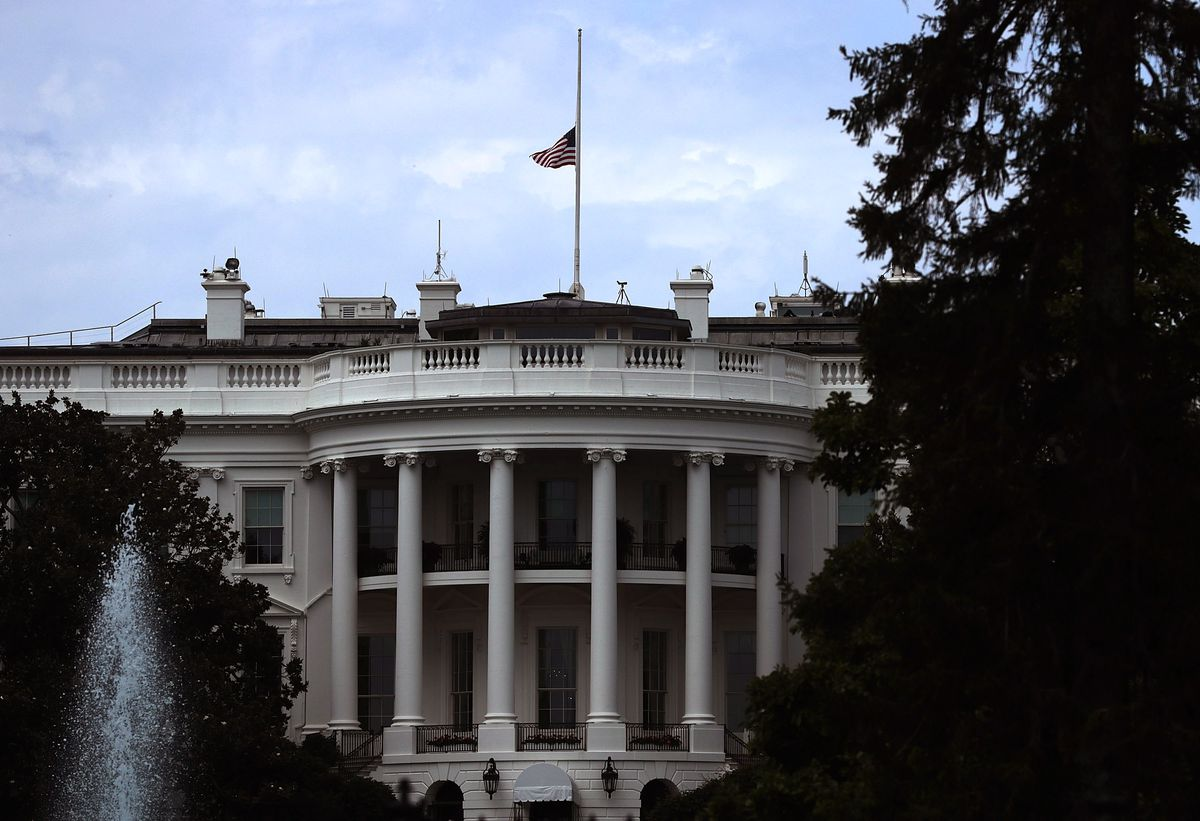 The White House with its flag at half mast