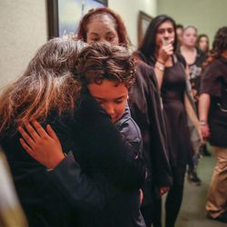 Diana Hall hugs her grandson, Matt Hall Jr., during his father's funeral at Myers Mortuary in Ogden on Saturday, April 15, 2017. Matt Hall was in jail for 15 months until he smashed his head into a wall and jumped off a railing in February. He was paralyzed from the shoulders down until dying from his injuries on April 7.