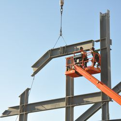 Another steel beam being moved into position in right field -