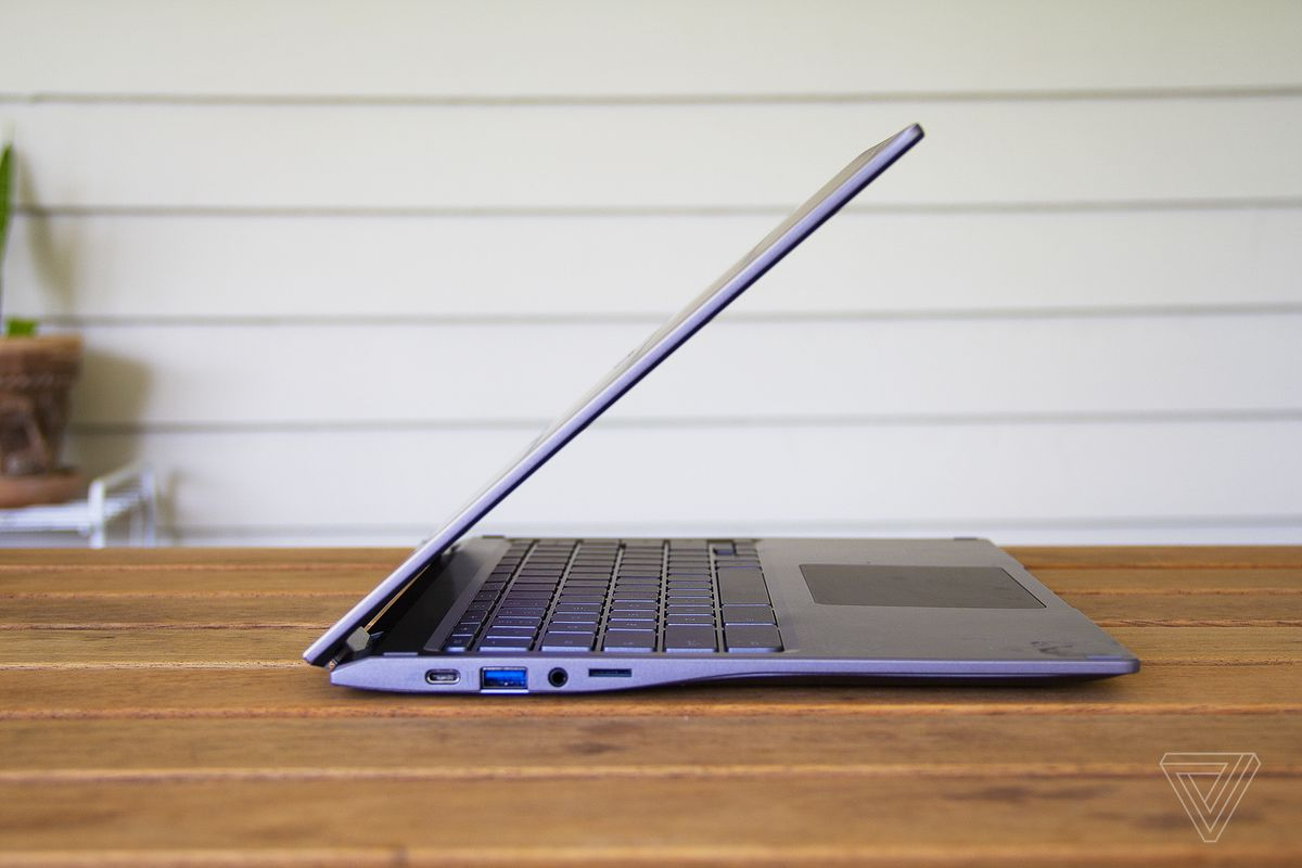 The Acer Chromebook Spin 713 half closed from the left side.