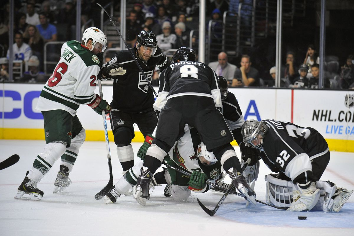 Zach Parise throws the kitchen sink at the Kings' Jonathan Quick in the hopes of scoring a goal.