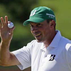Matt Kuchar holds up his ball after a birdie putt on the seventh green during the third round of the Masters golf tournament Saturday, April 7, 2012, in Augusta, Ga.