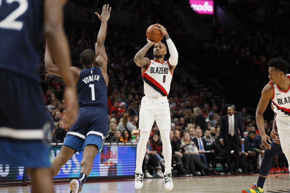 Portland Trail Blazers point guard Damian Lillard shoots the ball over Minnesota Timberwolves power forward Noah Vonleh during the first half at Moda Center.
