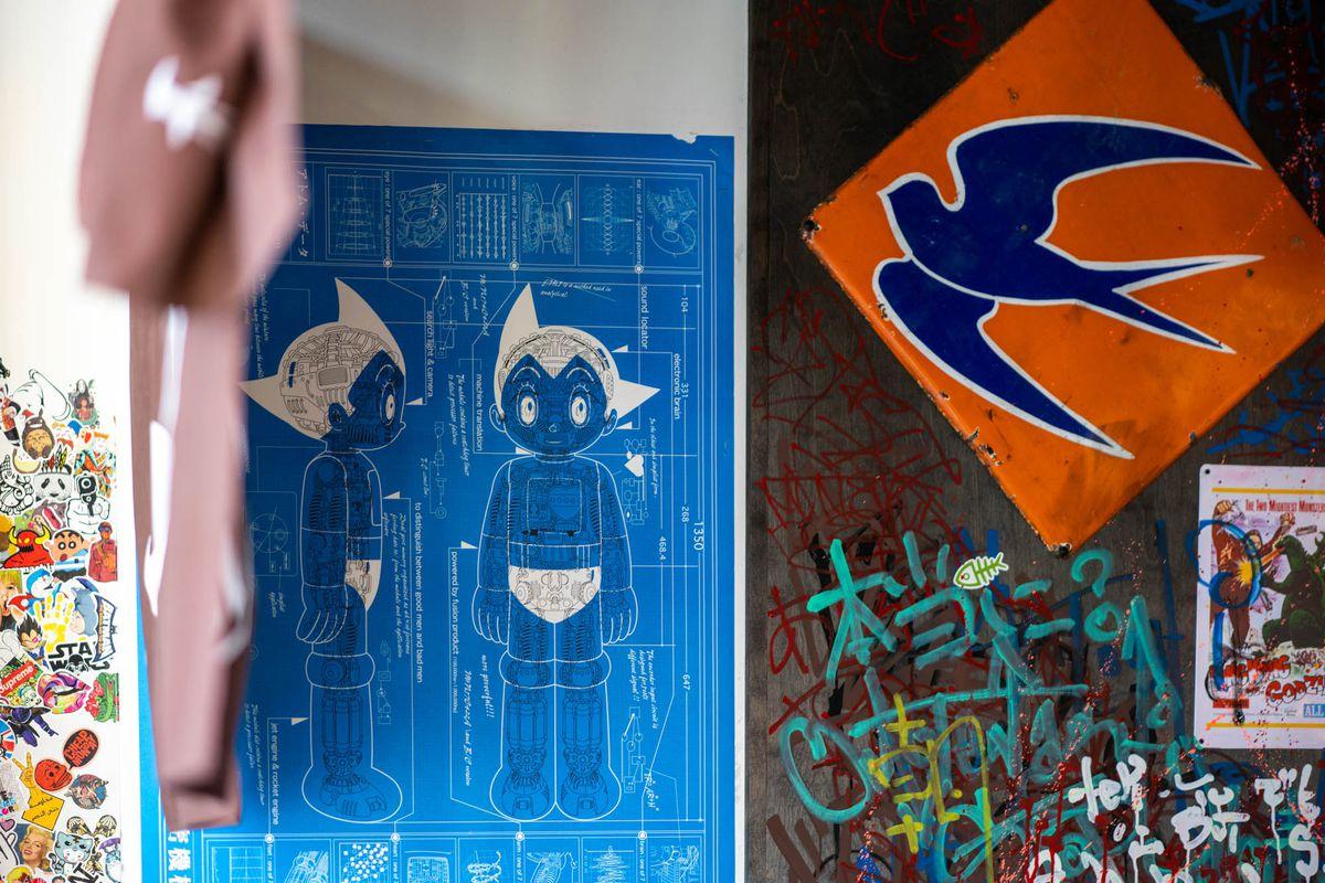 Anime artwork and graffiti on the walls at Taku