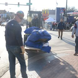 5:12 p.m. The Ernie Banks statue arriving, from the Brown Lot -