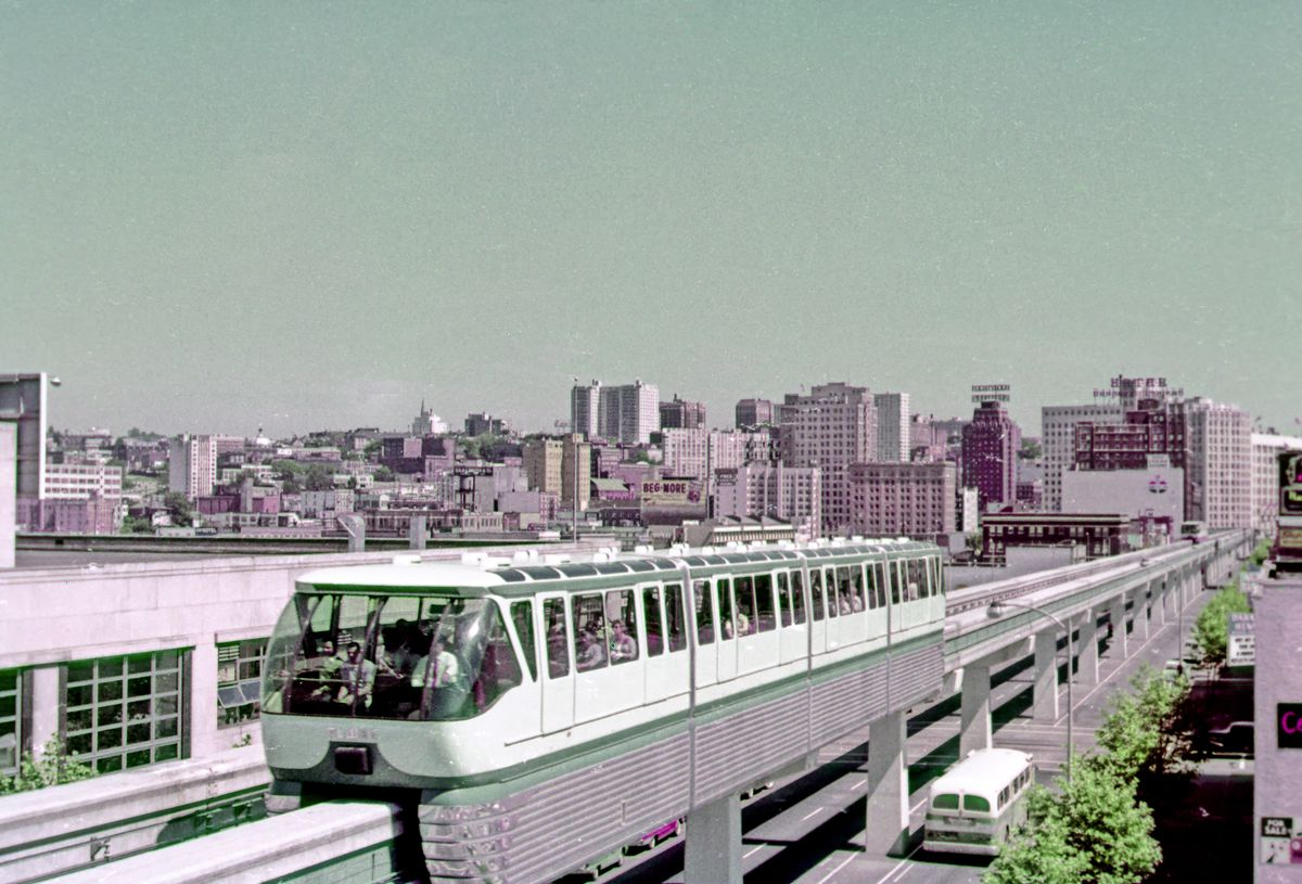 The monorail is pictured in an early color photograph, with heavy pink and green pigmentation.
