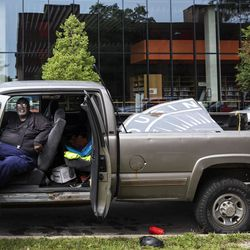 Quinn McKay, 60, co-founder of McKay Landscaping, sits in his truck, ready to take into storage an old Chicago Housing Authority sign sitting outside the sole remaining building from the Jane Addams Homes in the 1300 block of West Taylor Street, Wednesday, Aug. 21, 2019. The sign once hung at the Robert Taylor Homes, but there are no immediate plans for its restoration or display after years of neglect.