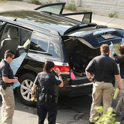 Crime scene investigators begin their work as Sandy police investigate a deadly shooting on Tuesday, June 6, 2017.