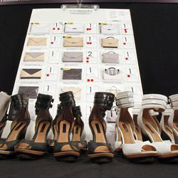 Shoes are lined-up on a table backstage before the BCBG MAX AZRIA Spring 2013 collection is modeled during Fashion Week in New York,  Thursday, Sept. 6, 2012.