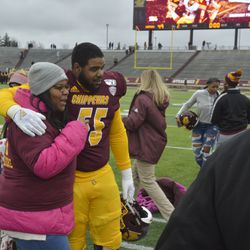 D'Andre Dill interacts with family post-game.