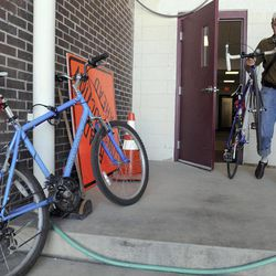 In this Aug. 30, 2012 photo, Mitch Lankford, an engineer with the city of Danville, Ill., leaves the Public Works Building. The city is doing an inventory of sidewalks and bicycle facilities for the city's MOVE Danville initiative, which is an effort by the city to make Danville more bicycle and pedestrian friendly.