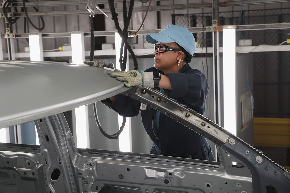 Workers assemble Ford vehicle at the Chicago Assembly Plant on June 24, 2019, in Chicago, Illinois.