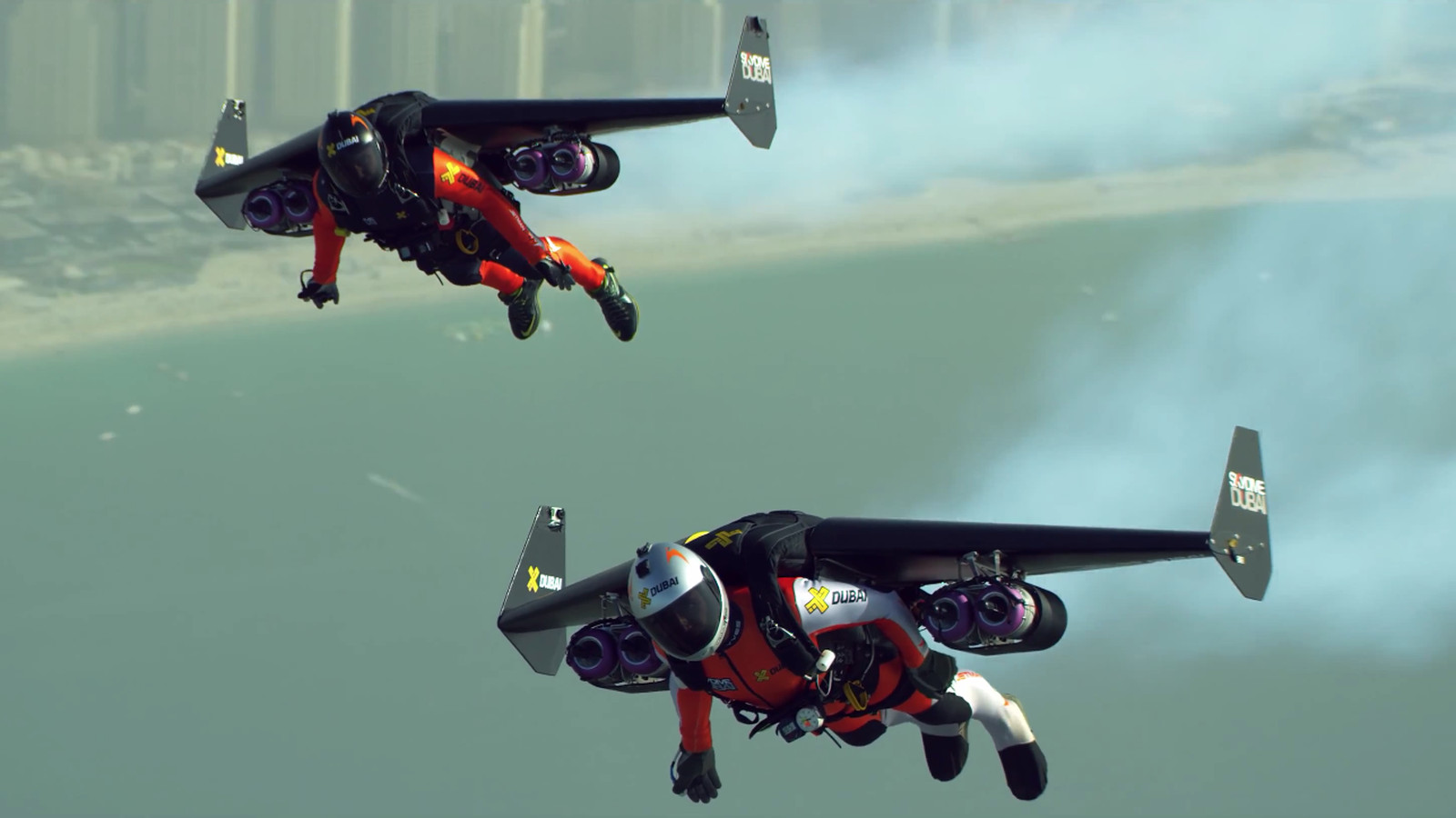 Watch Two Crazy People Fly Jetpacks Over Dubai In K The Verge - Crazy video of two guys flying jetpacks over dubai