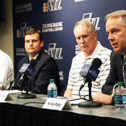 Randy Rigby, Utah Jazz President, right,  speaks as Dennis Lindsey, center, is introduced as the team's general manager at the Zions Bank Basketball Center in Salt Lake City, Tuesday, Aug. 7, 2012.