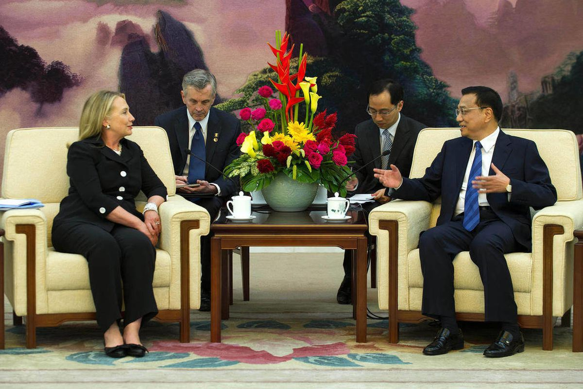 U.S. Secretary of State Hillary Rodham Clinton, left, speaks with Chinese Vice Premier Li Keqiang, right, during a bilateral meeting at the Great Hall of the People in Beijing, China, on Wednesday, Sept. 5, 2012.