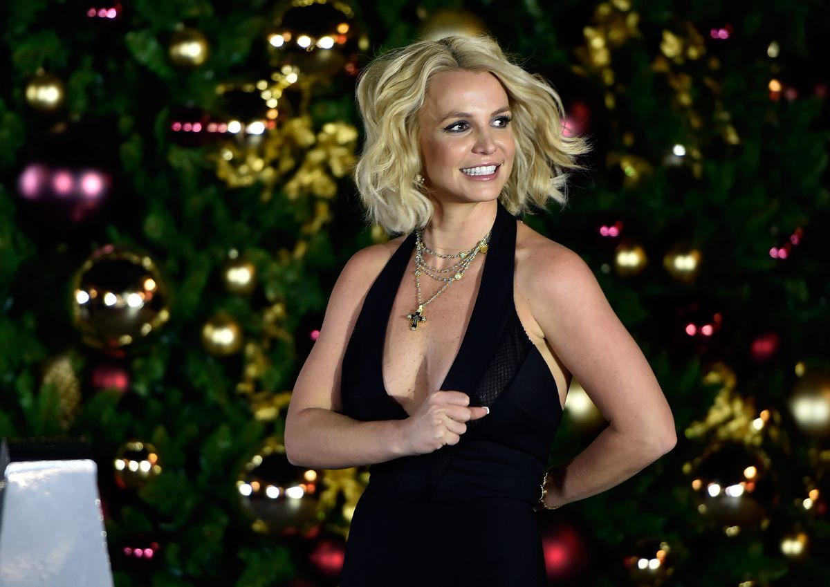 Singer Britney Spears arrives at a 2015 Christmas tree-lighting ceremony in Las Vegas. She's among the lineup for the 2016 B96 Jingle Bash in Chicago.(Photo by David Becker/Getty Images)