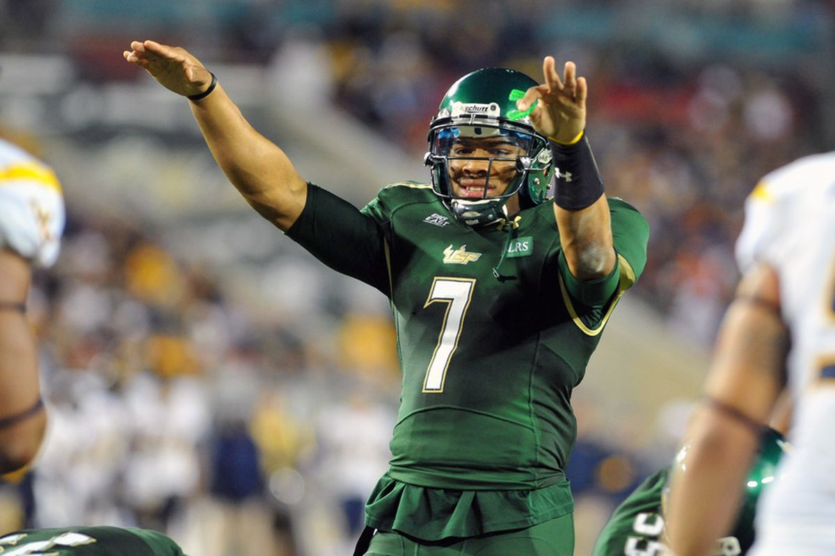 TAMPA, FL - DECEMBER 1:  Quarterback B. J. Daniels #7 of the   South Florida Bulls directs play against the West Virginia Mountaineers December 1, 2011 at Raymond James Stadium in Tampa, Florida.  (Photo by Al Messerschmidt/Getty Images)