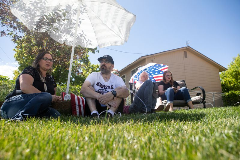 "Rayna Christensen, 39, left, her husband, Justin, and their children Keyera, 18, Kyle 16, Kaycia, 13, and Kanyon, 10, are pictured outside of their Grantsville home on Thursday, May 28, 2020. Justin Christensen was hospitalized for two months with COVID-19, during which time his family could only communicate with him through Skype. Rayna Christensen also tested positive for the virus. ""It's not biased,"" she said of the virus. ""It doesn't choose who it affects."""
