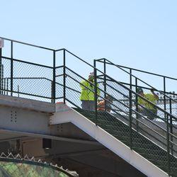 10:39 a.m. Still-unpainted railings in the left-field corner -