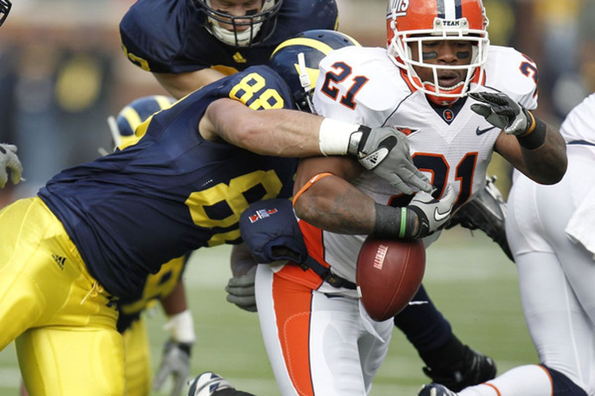 ANN ARBOR MI - NOVEMBER 06:  Jason Ford #21 of the Illinois Fighting Illini fumbles while being tackled by Craig Roh #88 of the Michigan Wolverines at Michigan Stadium on November 6 2010 in Ann Arbor Michigan.  (Photo by Gregory Shamus/Getty Images)