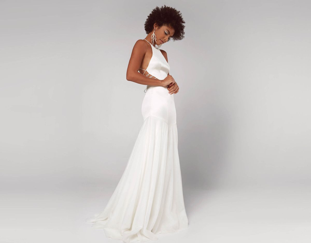 0a2ad0b60 The Charlotte ($699) A model wearing a sleeveless satin wedding gown