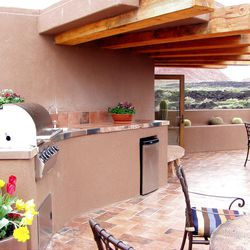 This outdoor kitchen in St. George showcases uninterrupted work zones for one cook.