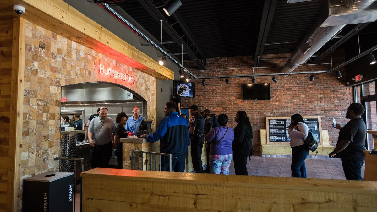 Customers stand in line at Bucharest on Livernois in Detroit on opening day.