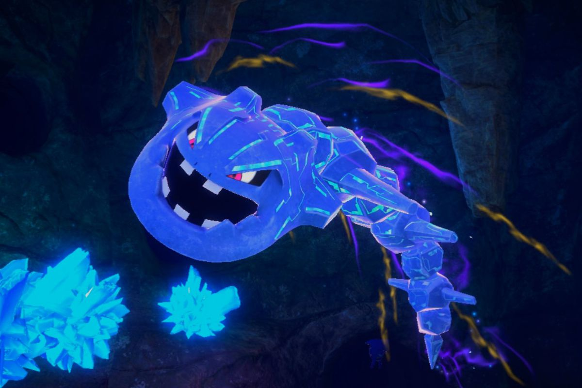 A Steelix jumps out of a cavern, glowing with blue streaks across its body