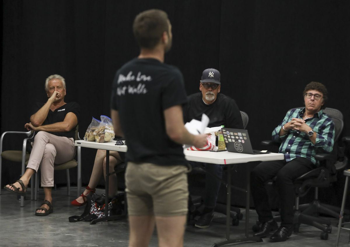 """Air Supply's Graham Russell, left, Craig Clyde and Sam Goldstein, a neurologist at the University of Utah, listen to actor John Patrick McKenna sing during rehearsal for the musical """"A Wall Apart"""" at the TV studio on the Salt Lake Community College campu"""