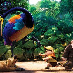 "Dug, Russell (Jordan Nagai) and Carl (Ed Asner) encounter a colorful bird creature in Pixar's ""Up."""