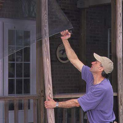 Man Removing Old Screen From Porch Screen