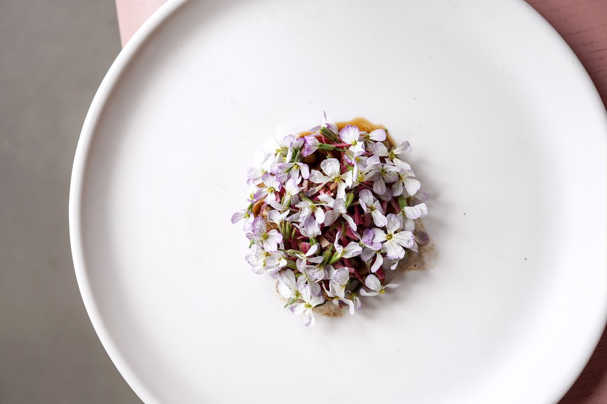 Cuttlefish with black garlic and radish flowers by Mei Lin