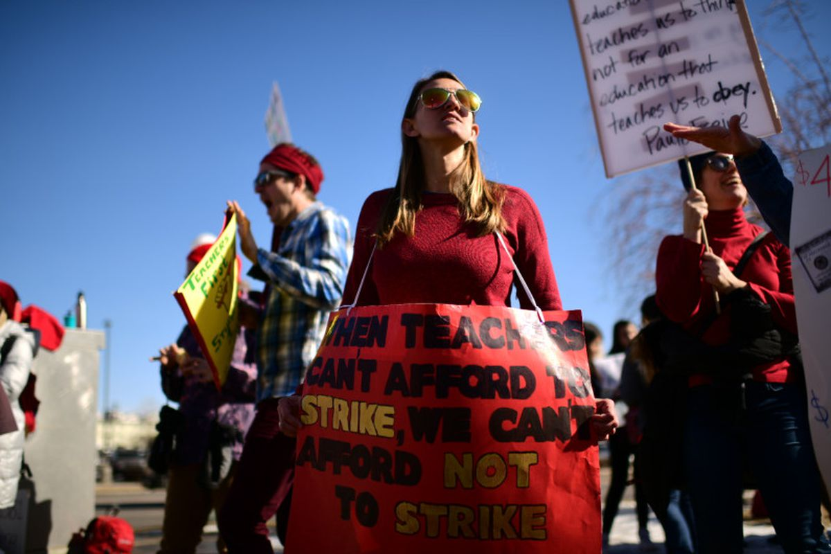 Teacher Rachel Patton rallies with other teachers outside Denver's North High School on Feb. 12, 2019.