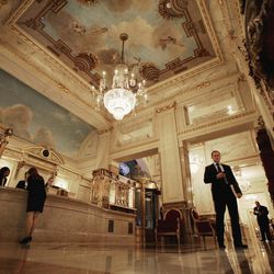 A man walks through the lobby of the New York's St. Regis Hotel on Wednesday, March 14, 2012. A century after the Titanic sank, the legacy of the ship's wealthiest and most famous passenger, John Jacob Astor, quietly lives on at the luxury hotel he built in New York City.