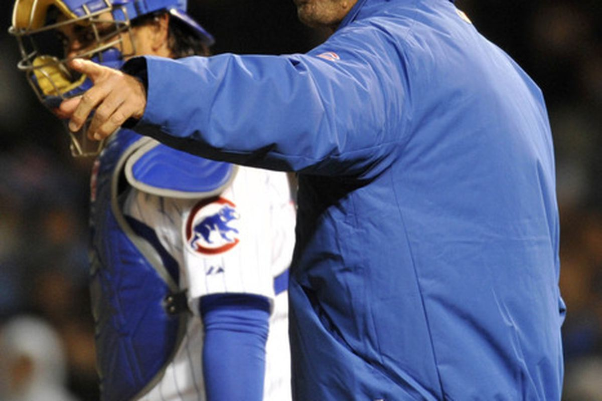 Chicago, IL, USA; Chicago Cubs manager Dale Sveum makes a pitching change in the eighth inning against the Milwaukee Brewers at Wrigley Field. The Milwaukee Brewers defeated the Chicago Cubs 7-5. Credit: David Banks-US PRESSWIRE