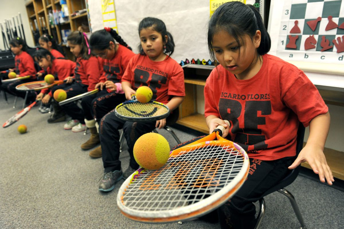 Samantha Belmontes, 7, tries to keep a foam ball rolling in the center of her tennis racket for as long as she can in a class at Ricardo Flores Magón Academy in 2011. (Photo By Helen H. Richardson/The Denver Post via Getty Images)