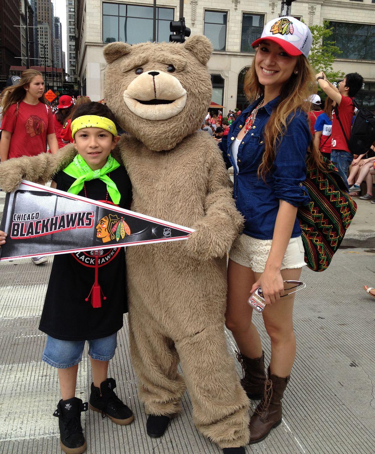 Gonzalez siblings Frankie, 9, Kaira, 24, and in the bear suit, 15-year-old Jennifer. | Maudlyne Ihejirika/Sun-Times