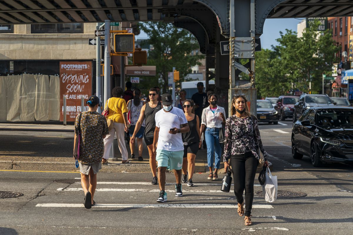 After-work commuters crossing Atlantic Avenue into Crown Heights.