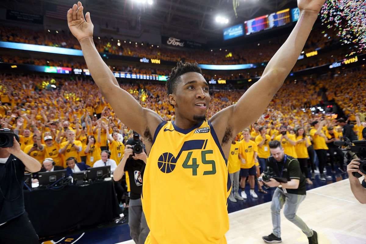 Utah Jazz guard Donovan Mitchell (45) celebrates as he walks off the floor as the Utah Jazz defeat the Oklahoma City Thunder in Game 6 of the first round of the NBA playoffs 96-91 and close out the Thunder in Salt Lake City on Friday, April 27, 2018.