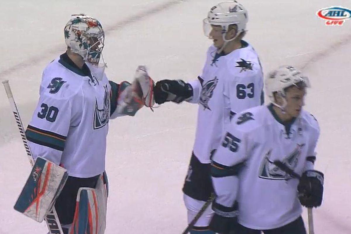 San Jose Barracuda goaltender Aaron Dell and defenseman Julius Bergman fist bump after Dell made 43 saves to backstop the Barracuda to a 5-3 win over the Stockton Heat at the SAP Center Friday night. (AHLLive.com)