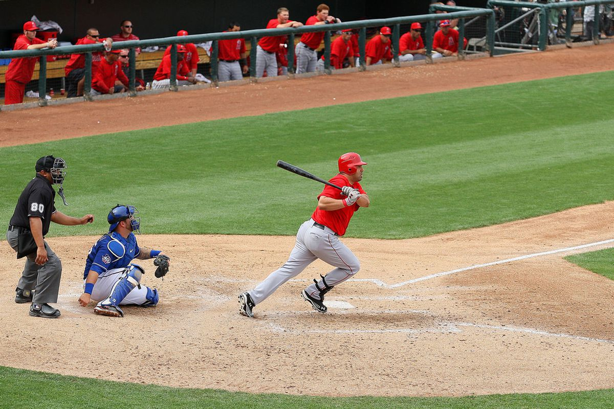 Mar 24, 2012; Surprise, AZ, USA; Los Angeles Angels first baseman Kendrys Morales (8) hits an RBI single during the sixth inning against the Texas Rangers at Surprise Stadium.  Mandatory Credit: Jake Roth-US PRESSWIRE