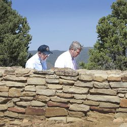 A moment of reflection is shared Friday, Sept. 21, 2012 between Interior Secretary Ken Salazar, left, and Agriculture Secretary Tom Vilsack as the two walk through the Ridge House ruins of the newly dedicated Chimney Rock National Monument west of Pagosa Springs, Colo. (AP Photo/The Durango Herald, Shaun Stanley)